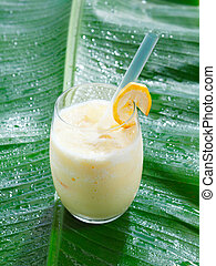 Single glass of chilled banana smoothie - High angle view of...