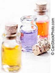 Aromatherapy essential oils - Three glass bottles of...