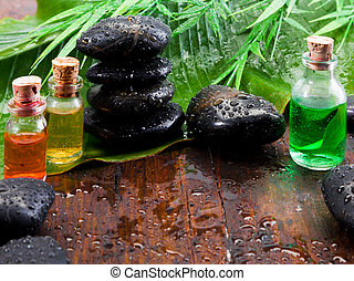 Aromatherapy spa treatment still life - Bottles of essential...