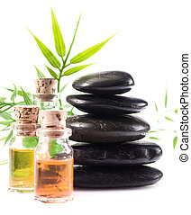 Massage accessories in a spa setting - Massage oils and...