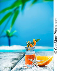 Orange essential oil treatment - A small glass bottle of...