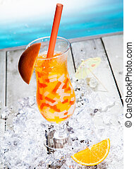 Fruity Boba Cocktail Tea standing in front of a beach...