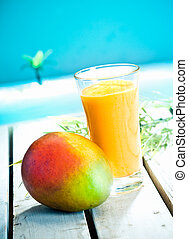 Creamy mango smoothie with blended fresh mango juice and...
