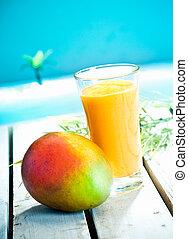 Creamy mango smoothie with blended fresh mango juice and...