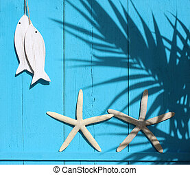 Maritime decorations on a bright blue wooden wall