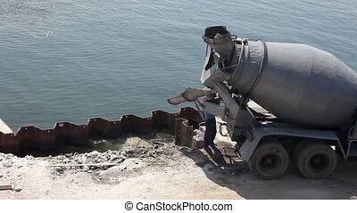 Concrete mixer at sea port.