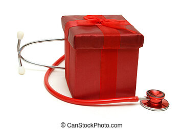 Heathcare Gift - A red gift box and stethoscope isolated on...