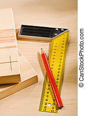 set-square ruler and pencil with boards