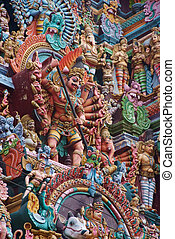 wall of colourful sculptures on Hindu temple, India