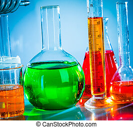test tubes with colorful liquids - Test tubes on blue...