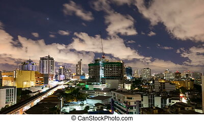 City at night with cloudscape