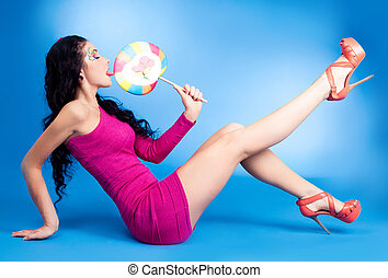 woman with lollipop - pretty young brunette woman with a...