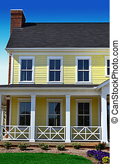 Yellow Cape Cod Style Home