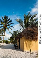 Beach cabanas huts Mexico Tulum Caribbean Riviera Maya...