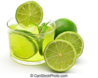 Mojito decorated with limes and ice