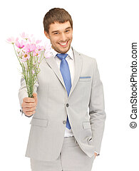 handsome man with flowers in hand - picture of handsome man...