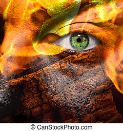 Face with green eye  painted with flames and wood