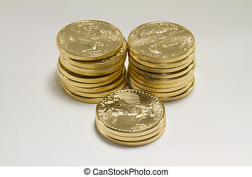 Stacks of Pure Gold Coins - Three stacks of pure gold United...