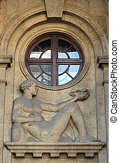 Building facade with relief of a woman in Zagreb, Croatia