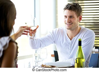 Couple Celebrating Something at a Restaurant - Portait of a...