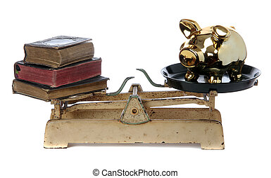 scale with books and golden piggy bank