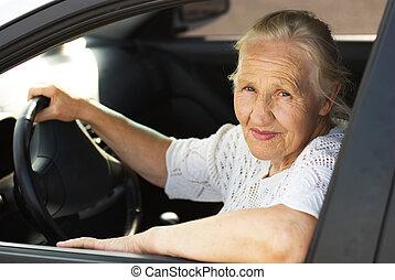 Elderly woman in a car