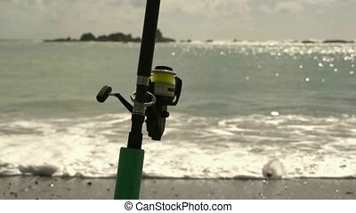 Fishing rod on the beach - Bay of Islands, New Zealand....
