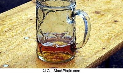 beer mug in rain