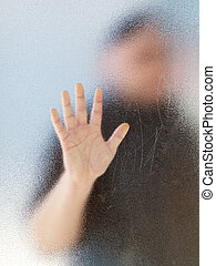 Silhouette of a mans body through frosted glassSilhouette of...