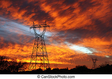 Electric Skies - Silhouetted power lines in the southwest...