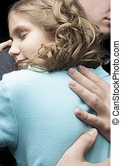 family sweet moment - father and daugther together embracing...