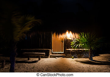 Beach cabanas huts at night Mexico Tulum Caribbean Yucatan...