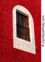 Window on a colorful facade in Merida Mexico