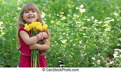 3s girl hugging a bouquet of yellow