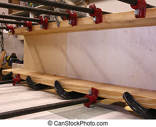 Clamps - Real woodworking shop: clamps holding workpiece...