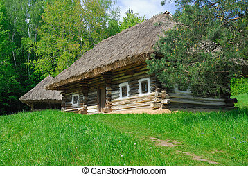 Ancient traditional ukrainian house with a straw roof,...