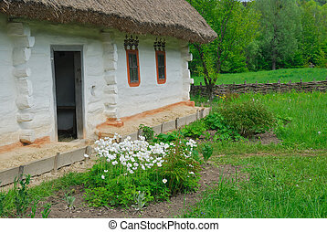 Ukrainian rural house with a straw roof, Pirogovo, Kiev -...