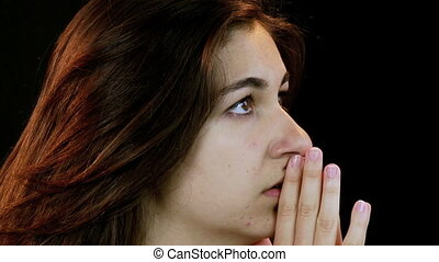 Intense Closeup of girl praying - Praying towards God asking...