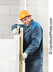 construction mason worker bricklayer with level -...