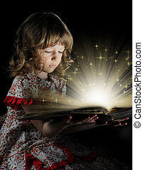 Teen girl reading the Book. - Teen girl reading the book on...