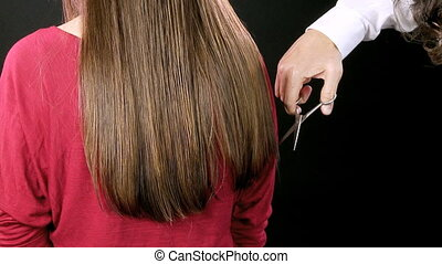 Hairdresser adusting haircut