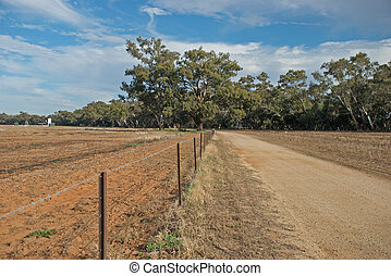 agriculture - a fence line between two farm paddocks