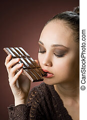 Chocolate gluttony - Very beautiful young brunette woman...