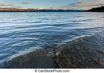 Distant snowy mountain range behind Lake Laberge - Fall snow...