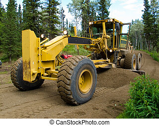 Grader resurfacing narrow rural road - Large yellow grader...