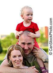 Happy family of three - Happy family portrait, outdoors