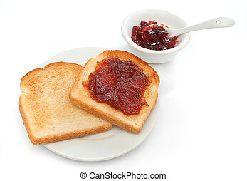 A beautiful breakfast scene - Two toast on a plate with red...
