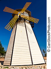 Beautiful windmill landscape with blue sky