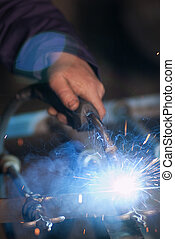 Worker Welding - Close up of a welding with many sparks