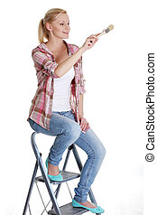 Young woman holding a paintbrush
